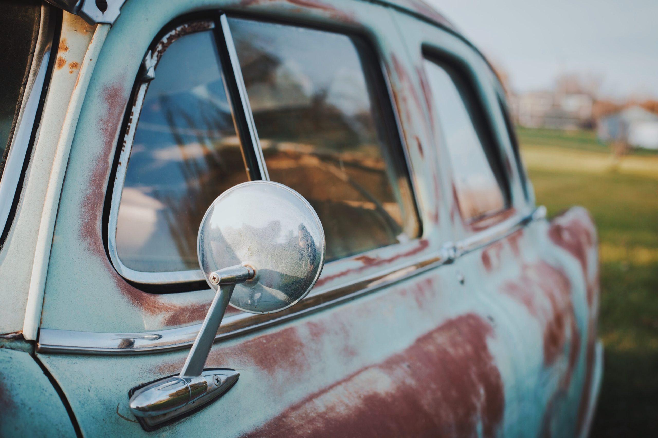 car rust on a blue car